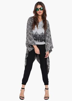 A super comfy and open cardigan. This cardigan has wrap detailing at sides with wide arm holes. Pair with trousers and graphic tee.