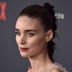 Rooney Mara completed her porcelain complexion and dark berry lip with warm mauve toned eyeshadow