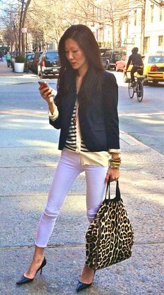 "Love the look of white pants in the summer - ""hint of summer and i'm wearing white and a cropped blazer. a simple classic look with my  favorite animal print bag from celine. my go to heels (for now :)  black pointy pumps"" marissa webb"