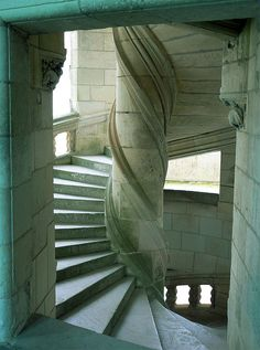 Castle of Chambord, or Château de Chambord, of Loir-et-Cher, France was built during the 16th century Renaissance. It has fascinating large double helical staircases designed by Leonard De Vinci which go into a spin until the ceiling. The two helices ascend the three floors without ever meeting.