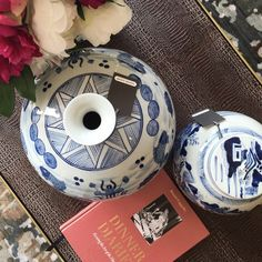 Alice Lane Home Collection   Blue and white vases on a coffee table