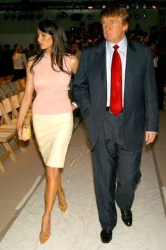 Melania Knauss and Donald Trump during MercedesBenz Fashion Week Spring 2004 Oscar de la Renta Front Row and Backstage at Bryant Park in New York...