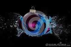 A purple bauble bursts, splashing around blue liquid