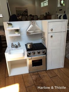 Harlow & Thistle - DIY Play Kitchen, toy kitchen with farmhouse sink and stainless steel stove.