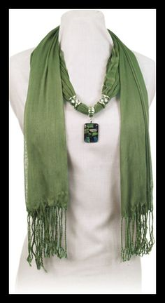Fashion and Jewelry all in one. Garden Girl Bling. I love that i can have a scarf and still have a jewelry pendant.