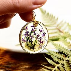 Check out our pressed flower jewelry selection for the very best in unique or custom, handmade pieces from our jewelry shops. Artisan Jewelry, Handmade Jewelry, Unique Jewelry, Handmade Gifts, Real Flowers, Purple Flowers, Resin Jewelry, Jewelry Shop, Feng Shui Jewellery
