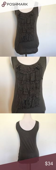 🆕J. Crew Silk Ruffle Front Sequin Beaded Tank Gorgeous grey J. Crew silk ruffle front tank top with sequined Beaded embellishments all over front ruffles. 100% cotton tank. Size XS. Brand new with tags. ❌NO TRADES❌NO LOWBALLING❌ J. Crew Tops Tank Tops