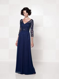 Chiffon A-line dress with hand-beaded illusion three-quarter length sleeves, V-neck beaded illusion over a sweetheart bodice with empire waistline and keyhole back, gathered skirt, suitable as a mother of the bride dress or a formal gown. Sizes: 4 – 20,16W – 26W