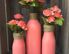 Sage hand painted wine bottles with twine and burlap flowers.