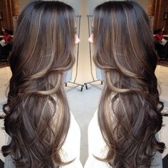 Her length and layers are gorgeous. Hopefully my hair will reach this length soon.