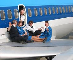 LOVE this!! KLM hostess crew is having a picnic (sort-of) on a wing in Amsterdam - good times!