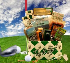 Tee It Up Gift Box Tee time! Its time to Tee off and pack up your favorite golf treats. Included in this Tee It Up gift box are practice golf balls, golf themed peanuts, a 250 page book of golf wisdom as well as an array of sweet and savory snacks. Gifts For Golfers, Golf Gifts, Gift Baskets For Him, Golf Gift Baskets, Food Baskets, Raffle Baskets, Unique Gifts For Men, Gourmet Gifts, Sports Gifts