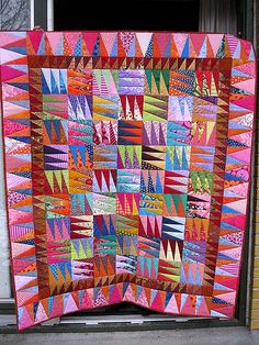 "Linda made the beautiful quilt in many colors as a Christmas present for her husband. Pattern from Kaffe Fassett's book ""Patchwork"""