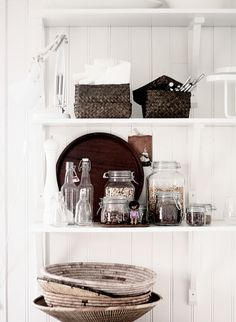 making storage look nice - wicker, glass, and white