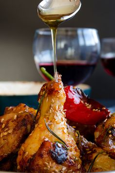 Honey sesame chicken wings coated with pomegranate molasses and honey. Drizzle a little extra honey when serving! | giverecipe.com | #chicken #sesame