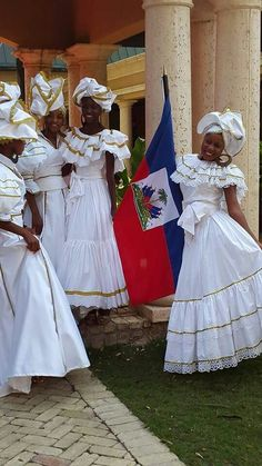 ((Mercedes...her second dress... 'cause she gotta have at least two...at *least*--/SHOT)) Haitians in Karabela dresses