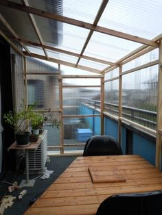 Easy DIY patio enclosure using 2x4's and hard plastic sheets. Would work well in warmer climates, but most likely not strong enough to withstand a heavy snow load.