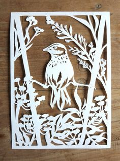 I love little birds and wild flowers. Both of them are pictured in this handmade papercut. Each papercut is handdrawn and cut by me. For this one I looked at several pictures in my beautiful nature books. The design is a mix and match of both photos and imagination. It takes a good while before Im satisfied with my design, but when I finally am, I start cutting my drawing out of the single sheet of paper with a little sharp knife. This time-consuming process makes every piece totally unique…