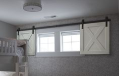 Mini Barn Door Shutters Perfect For Small Spaces House Stuff Basement Renovations, Home Remodeling, Basement Plans, Basement Makeover, Garage Plans, Basement Remodel Diy, Remodeling Companies, Bathroom Remodeling, Diy Barn Door Plans
