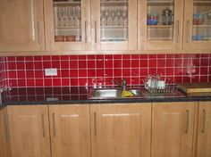 I want this red backsplash in my kitchen. I am looking for the right shade of red. so far, no luck at home depot...