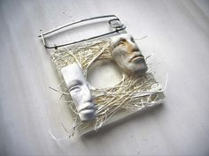 """""""Vows"""" - polymer clay and mixed media brooch by Sonya Girodon."""