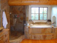 Stone Bath in a Lake Tahoe, Adirondack home by Kathleen Burke Design