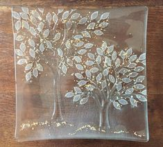 Kiln formed clear glass trees.