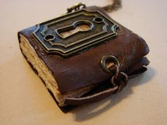 Miniature-book necklace pendants. Must make these! could be any theme... steampunk, paganish, vintage costumes
