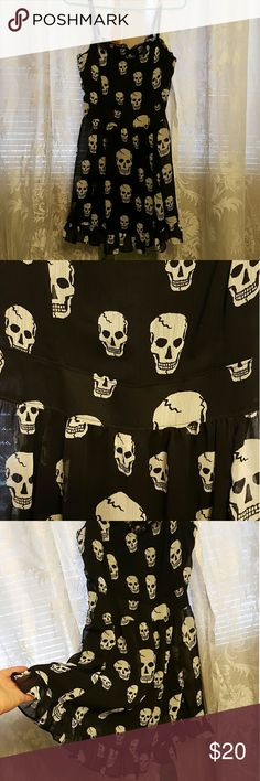 Price reduced!! Skull print black dress Here's a black dress with white skulls all over it. Super light weight. So cute. From smoke free home. Never worn. Bought from Hot Topic. Royal Bones by Daang Dresses