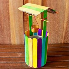 How to make a colorful mini wishing well via @Guidecentral - Visit www.guidecentr.al for more #DIY #tutorials