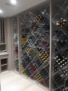 Lucite wine racks refresh the traditional wine cellar. | Brooks and Falotico Associates Fairfield County Architects