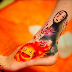 This fiery fusion between Calcifer and No-Face. | 27 Studio Ghibli Tattoos That'll Make Your Heart Croon