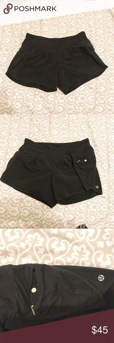 "LULULEMON  Black Running  Zipper Pockets Shorts LULULEMON  Black Running Athletic Yoga Side Zipper Pockets Shorts Size 4 very good condition both sides has zipper pockets with a logo on one leg.   MEASURED FLAT (in inches):  WAIST: 14""  LENGTH: 10""  INSEAM: N/A lululemon athletica Shorts"