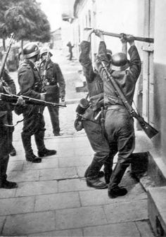 Poland. German Nazi troops forcing entry into a building, September 1939