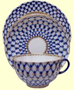 Lomonosov Russian Porcelain Cobalt Net Trio Tea Cups and Saucer with 7-inch Dessert Plate.  Love the blue and white tea cups made by the Russians.
