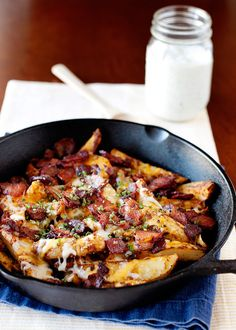 {Baked chilli cheese fries with bacon and ranch.}