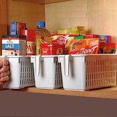 """Cupboard-Tamer™ storage basket lets you quickly group foodstuffs, cleaning, other home supplies in one spot to reduce clutter and organize cupboard, cabinet and closet space. Vertical grip makes it easy to access, slide out for viewing items, and transport with one hand. Also use in bathroom, laundry room and work area. Polypropylene, 12 1/4""""L x 6""""W x 5 1/2""""H. $9.98"""
