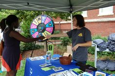 Spinning the wheel and winning prizes with UNCG Career Services Center. Buy this Prize Wheel at http://PrizeWheel.com/products/floor-prize-wheels/floor-table-black-clicker-prize-wheel-12-slot/.