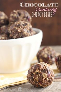 Energy Bites  2/3 cup natural peanut butter substitute for almond butter 1/2 cup organic raw honey 1 1/2 teaspoon vanilla 1 cup rolled oats {I use these.} 1 cup unsweetened coconut flakes 1/4 cup cocoa powder 1/2 cup finely chopped walnuts {or pecans} 1/2 cup dried cranberries 1/2 cup mini chocolate chips {these are our favorites}