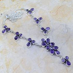 "Brand New Amethyst Necklace with the largest stone being 5 x 7mm and all stones set in a .925 Sterling Silver setting. The necklace is 19"" in length. - $21.95 -  ** An extender of up to 2 inches can be added for FREE if the necklaces is not long enough.**"