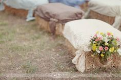 If I EVER get married I want to be married in the middle of a beautiful field on a horse. I would like my guest to sit on bales of straw with either quilts or nice blankets. Love this idea