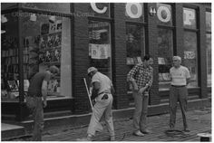 """ID#0214 Date: Unknown. This image shows a work crew installing the Co-op's heated sidewalk in front of their new building. Oberlin architect Doug Johnson is on the right conversing with a member of the crew.  Participant: Liz Burgess. Additional Sources: Oberlin Heritage Center: Fred Maddock files; McQueen, Albert, """"A Brief History of the Oberlin Consumers Cooperative and its Businesses.""""; Inge, Angela. """"A long Co-op History"""" Chronicle-Telegram, June 18, 2000."""