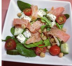Salmon salad with chick peas, cucumber, cherry tomato, feta and spinach