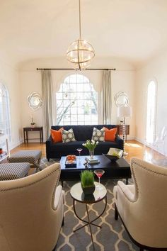 color story - navy couch, grey rug, beige chairs, pops of orange  Georgette Westerman Interiors