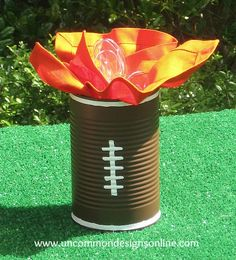 Tailgating Ideas... - football painted can used as a plasticware container