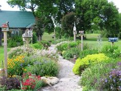 rustic birdhouses as garden accents  ~ Photo: Courtesy of Judy Burton