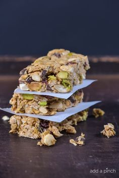 Dark Chocolate Cherry Pistachio Granola Bars Recipe - These are so full of mouthwatering ingredients that they have quickly become our fave granola bars! Great to pack for camping trips, healthy snacks or a quick breakfast! LOVE! from addapinch.com
