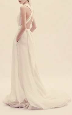 Crossed-strap back wedding dress. Absolutely stunning blend of casual chic and classic romantic bridal style.