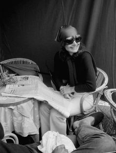 9e142f28cf49 jackie kennedy in her iconic sunglasses and head scarf.... Jaqueline Kennedy ,