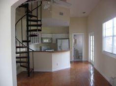 Spiral staircase to the kitchen <3 only good if there is a second staircase to the upstairs on the opposite side of the house, I absolutely love the idea of the spiral staircase though!